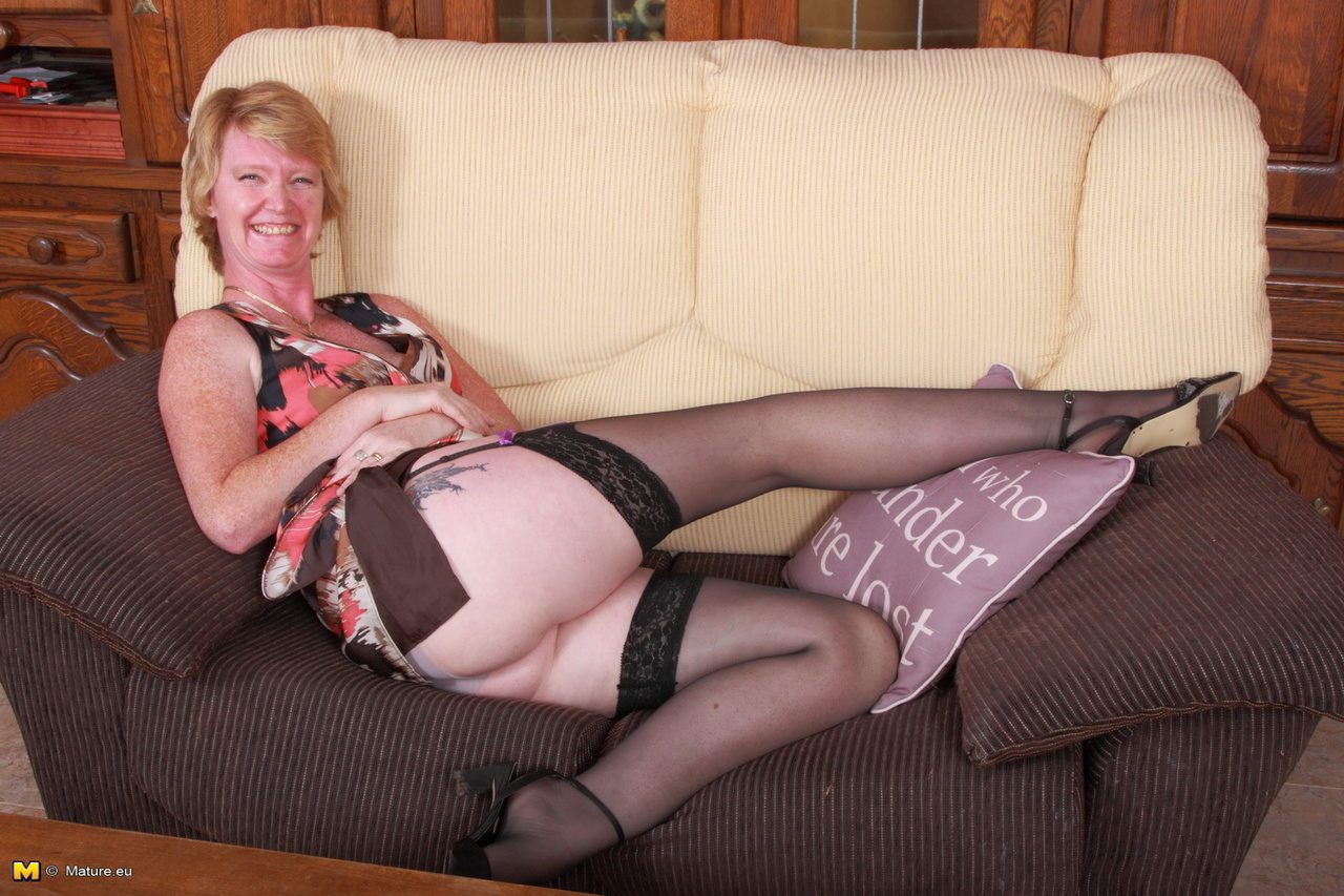 Freckled milf redhead dazzles in black stockings