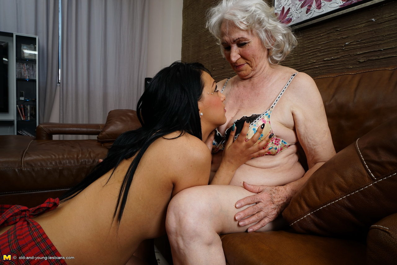 Granny goes down on a shaved schoolgirl cunt